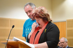Anna Osborne reads out her victim impact statement, supported by friend Tom Daly. Photo / Greymouth Star