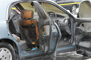 Two children were saved from almost certain death in the burning car. Photo / Gisborne Herald