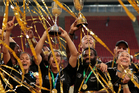 The New Zealand men's and women's sevens teams celebrate after winning World Cup titles. Photo / AP