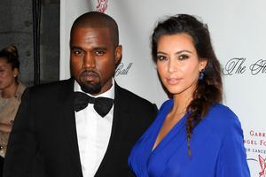 Kanye West, left, with his girlfriend Kim Kardashian. Photo/AP