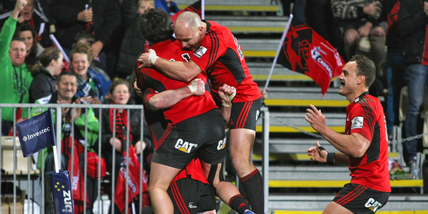 The Crusaders celebrate a try during their 43-15 win over the Chiefs. Photo / Getty Images