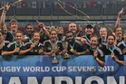 The New Zealand men's and women's sevens teams celebrate after winning World Cup titles. Photo / Martin Seras Lima IRB.com