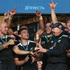 The New Zealand men's team celebrate with their trophy after winning the Rugby Sevens World Cup. Photo / AP