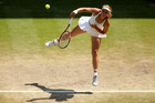 Sabine Lisicki of Germany serves during the Ladies' Singles final match against Marion Bartoli of France on day twelve of the Wimbledon Lawn Tennis Championships. Photo / Getty Images