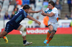 Riaan Smit of the Cheetahs (R) is tagged by Angus Ta'avao of the Blues. Photo / Getty Images