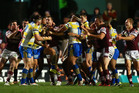 A melee erupts after Mitchell Allgood of the Eels punched Steve Matai of Manly. Photo / Getty Images