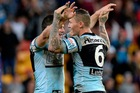 Todd Carney and Michael Gordon celebrate the Sharks one-point win over the Broncos. Photo / Getty Images
