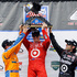 Scott Dixon, center, poses with the trophy in Victory Lane with help from second-place finisher Charlie Kimball, left, and third-place finisher Dario Franchitti, of Scottland. Photo / AP