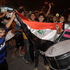 Iraqi soccer fans wave a national flag as they celebrate after the Iraqi national soccer team beat South Korea in the Under-20 World Cup quarterfinal, in Baghdad, Iraq. Photo / AP