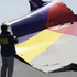 This image released by the National Transportation Safety Board shows an NTSB agent photographing a part of the Boeing 777 Asiana Airlines Flight 214 aircraft that crash landed in San Francisco. Photo / AP