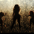 "Singer Beyonce, center, performs on her ""Mrs. Carter Show World Tour 2013"" during the Essence Festival at the Superdome in New Orleans. Photo / AP"