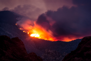 Smoke from the Carpenter 1 Fire on The Red Rock Canyon road and Calico Basin. Photo / AP