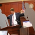 Defense counsel Mark O'Mara carries life-size cutouts representing George Zimmerman and Trayvon Martin in the courtroom during closing arguments in the trial of George Zimmerman. Photo / AP