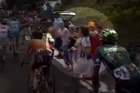 A Tour de France fan gets punched in the face while chasing the cyclists on foot. Video / Youtube: Knoetoe.