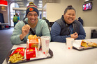 Domasi Tomasi and Maryanne Nuuausala enjoy their burgers at McDonald's. Photo / Natalie Slade