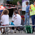 An ambulance worker stands in a cordoned-off area near a man with a blood-splattered shirt, on the site of a train accident in the railway station of Bretigny-sur-Orge. Photo / AP
