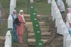 Mourners gather in Srebrenica to commemorate the massacre of some 8,000 Bosnian Muslims killed by Serb forces 18 years ago.