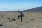 Rhys Darby dances on the Mars-like barren landscape.
