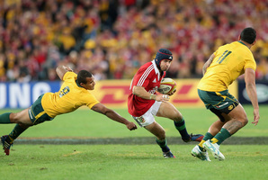 Leigh Halfpenny races away from Will Genia of the Wallabies in the course of delivering a stunning performance for the Lions in Sydney. Photo / Getty Images