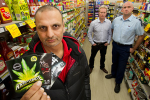 Putaruru retailer Sid Patel, pictured with Associate Health Minister Todd McClay and Sergeant Jason Shailer, right, has decided to stop stocking legal highs. Photo / Alan Gibson