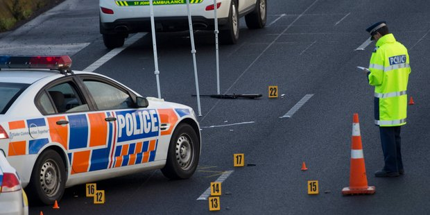 Police investigate the scene where a man was shot on the Northern Motorway near Constellation Drive. Photo / Greg Bowker
