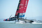 Emirates Team New Zealand sails solo around the course after Luna Rossa boycott the first race of the Louis Vuitton Cup. Photo / Chris Cameron