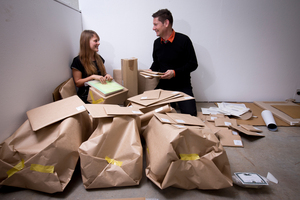 Catherine Ellis and Evan Woodruffe prepare the 85 contemporary artworks to be given away. Photo / Dean Purcell