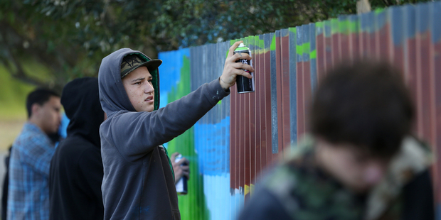 Te Arahi Wilson, 17, was one of several youths who painted a fence in Te Puna as part of a restorative justice program. Photo / Joel Ford