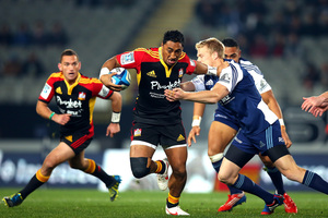 The Chiefs' Bundee Aki tries to push off Baden Kerr at Eden Park last night. Photo / Getty Images