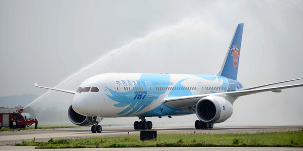 A Boeing 787 passenger jet operated by China Southern Airlines is welcomed with a spray of water after its arrival in Guangzhou. Photo / AP