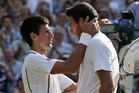 Novak Djokovic, left, and Juan Martin Del Potro share a moment after their gruelling clash. Photo / AP