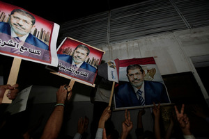 Yemeni protesters hold posters of Egypt's ousted President Mohammed Morsi. Photo / AP