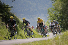 Chris Froome (yellow jersey) descends Val Louron-d'Azet pass with Alejandro Valverde (second) and Alexander Quintana ( in white). Photo / AP