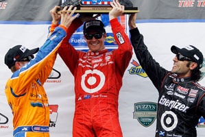 Charlie Kimball (left), Scott Dixon and Dario Franchitti had plenty to celebrate. Photo / AP