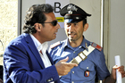 Captain Francesco Schettino arrives for his trial. Photo / AP