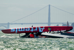 The Artemis Racing AC72 catamaran, an America's Cup entry from Sweden, lies capsized after turning over during training in San Francisco Bay. File photo / AP