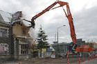 Demolition of the earthquake damaged Cranmer Court in Christchurch. The earthquakes showed many building owners the importance of proper insurance cover. File photo / Geoff Sloan.
