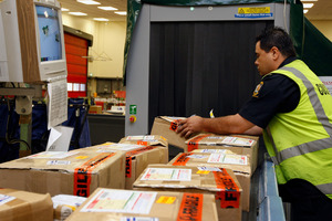Packages coming in from overseas at the Auckland Mail Centre. Charging GST on goods bought overseas online would be 'virtually impossible' said Customs Minister Maurice Williamson. Photo / NZ Herald