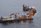 The Smit Borneo working at the site of the Rena grounding. Photo / APN