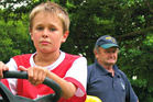 Ceejay Denes, 10, is fundraising for the Cancer Society Wairarapa and getting his 'mop chopped' for his grandad Neil Smith, who has brain cancer. Photo / WTA