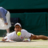 Djokovic looks at the ball after slipping during the Wimbledon men's singles final. Photo / AP