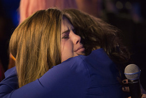 Cassie Henderson hugs Jackie Thomas after being eliminated from The X Factor.