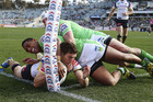 Ashley Graham of the Cowboys is forced into touch by Sami Sauiluma and Jarrod Croker. Photo / Getty Images