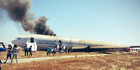 View: Flight 214 crashes on landing