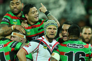 Todd Lowrie looks on as Rabbitohs players celebrare a try. Photo / Getty Images