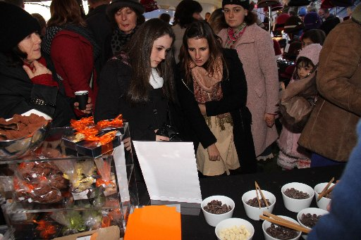 The night market at the Olive Harvest Festival in Martinborough's town square. Fernanda Lago (left) and Deborah Ramos, both from Brazil, contemplate the Schoc chocolate stall.