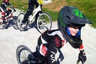 A child competes in the North Harbour BMX champs.