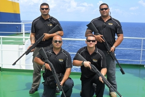 Hemi Anisi (rear left) and his fellow ex-New Zealand servicemen working in maritime security favour a modern version of the self-loading rifle.