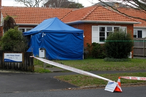 Police set up a cordon round the house after the body was found. Picture / Christine Cornege