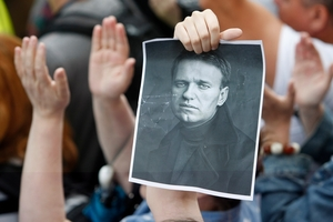 Protesters took to the streets in Moscow after Alexei Navalny was sentenced to five years in prison on fraud charges. Photo / AP